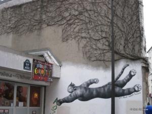 Flying cat street art in Menilmontant